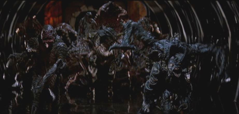 in-the-mouth-of-madness-1995-demons-tunnel-scene